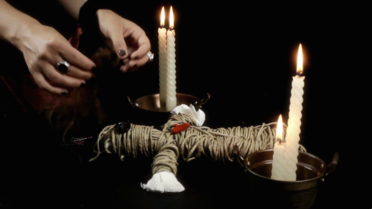 voodoo-doll-candles-pins-hair-a-witch-fastening-human-hair-to-a-creepy-voodoo-doll_e1xgtkbjg__F0000